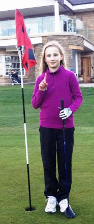 Emily James celebrates her hole in one