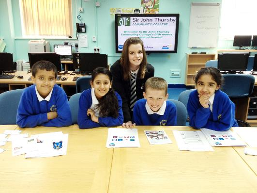 A money mentor from Sir John Thursby School gives a lesson to pupils at Heasandford Junior School