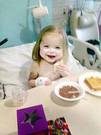 Ella enjoys a bowl of Coco Pops after her operation