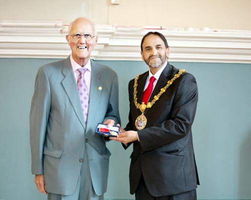 Alan Whalley receives the inaugural Ruby Award from new mayor, Coun Munsif Dad