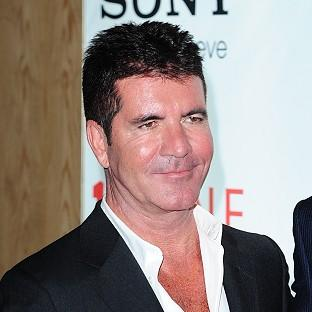 Simon Cowell hopes One Direction's fans will stick by them