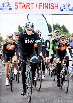Sir Bradley Wiggins surrounded by other cyclists taking part in last year's event