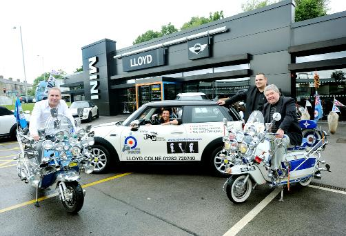 Lloyd Mini in Colne getting ready for the Mod invasion. From left, Steve Reid, Sue Madigan, Matt MacDonald and Lionel Snowden with some spectacular scooters.
