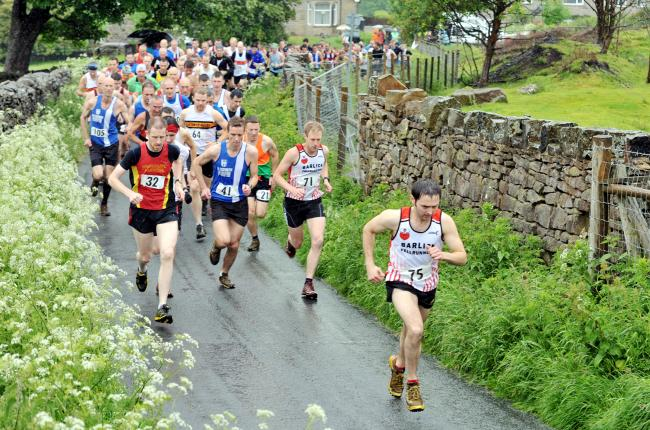 Race winner Jimmy Craig leads the field at the Weets Fell Race
