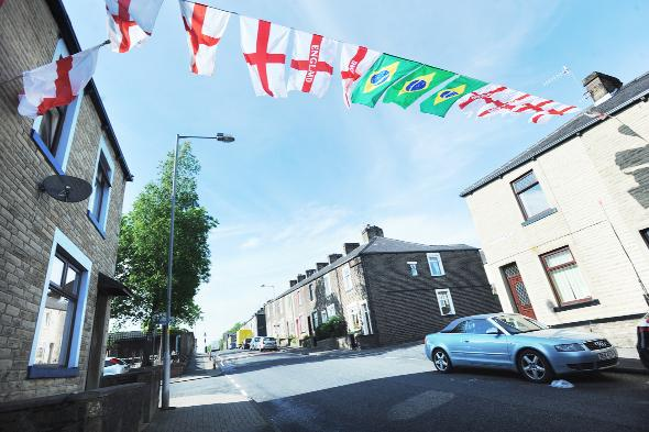 Lancashire Telegraph: Flags across Queen Victoria Road, in Burnley