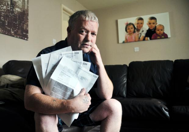 Paul Clegg with the letters he received from the health trust