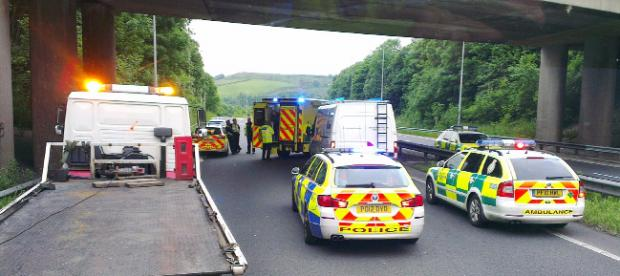 Lancashire Telegraph: Police and paramedics at the scene