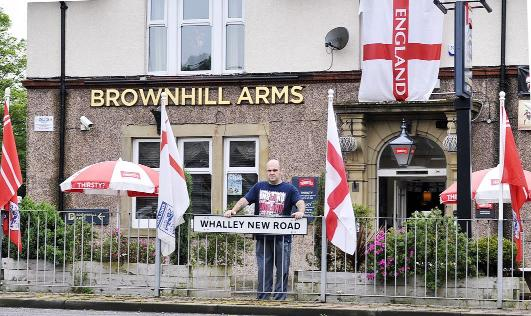 Lancashire Telegraph: Landlord Kris Ball outside his pub with the England flags