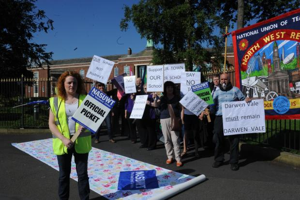 Lancashire Telegraph: Members of the National Union of Teachers and National Union of Schoolmasters Union of Women Teachers have been joined by concerned parents on the picket line