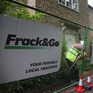 Environment campaigners stage an anti-fracking protest outside David Cameron's Oxfordshire home (Greenpeace/PA)