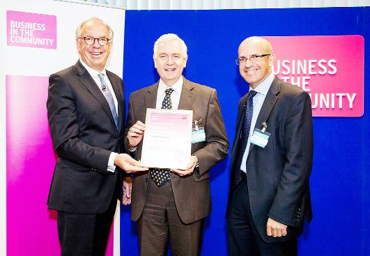 3M technical director Wynne Lewis (centre) receives the award from BITC chief executive Stephen Howard (left) and Jonathan Garratt of the awards sponsors Jaguar Land Rover