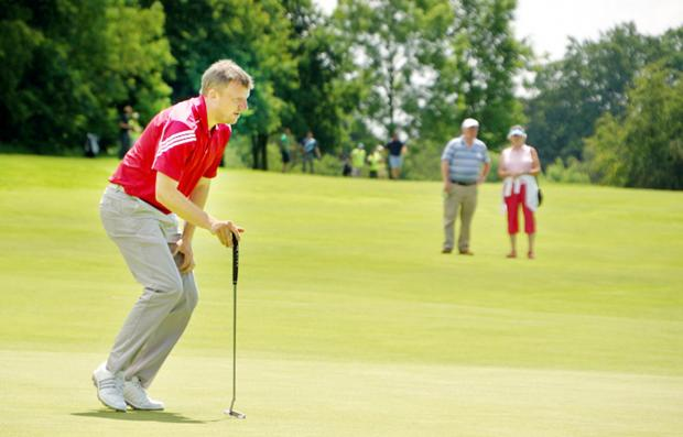 Mark Young lines up at putt at Clitheroe