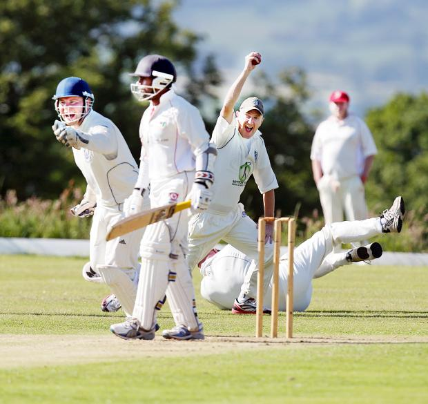 Whalley's Richard Palmer celebrates brilliantly catching Salesbury's Susantha Pradeep Picture: KIPAX