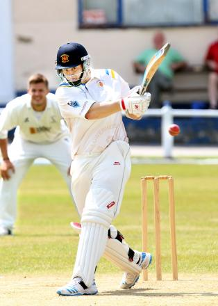 Lowerhhouse's Ben Heap smashes the ball to the boundary against Burnley Picture: KIPAX