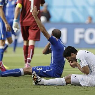 Uruguay's Luis Suarez, right, is under investigation by FIFA (AP)