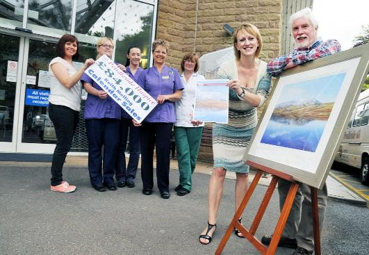 Artist Keith Melling with Christina Cope and other staff members of the hospice