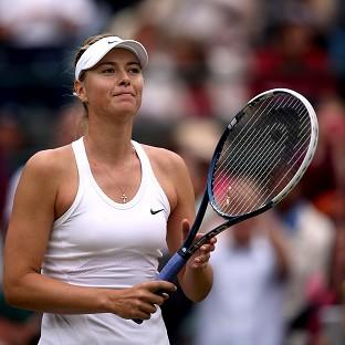 Maria Sharapova eased to victory over Switzerland's Timea Bacsinszky