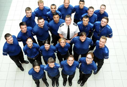 Chief Superintendent Chris Bithell, centre, with the 22 new PCSO recruits