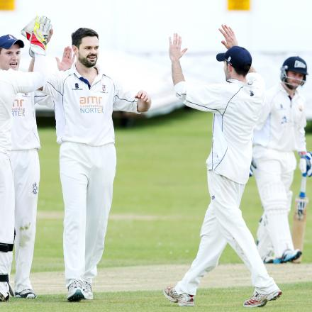 It's high fives for Padiham's Duncan Hall (centre) after dismissing Ribblesdale Wanderers Charlie Jackson