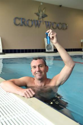 Steven Greenwood back at training pool, Crow Wood, with his medal