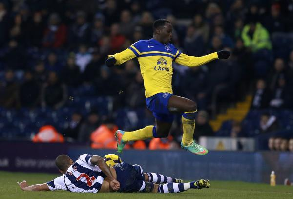Everton's Romelu Lukaku jumps over Steven Reid