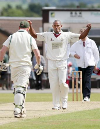 Brenton Parchment celebrates the dismissal of Paul Clifford Picture: KIPAX
