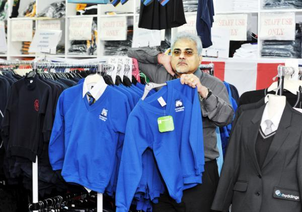 Lancashire Telegraph: Shop owner Rohni Vij with the outdated Accrington Academy schoolwear