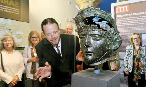Curator Patrick Tostevin with the Ribchester Helmet