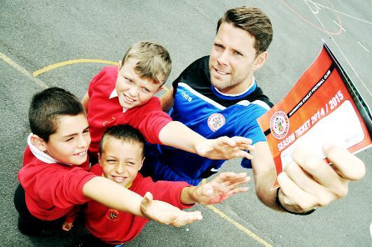 Stanley manager James Beattie. Above, handing tickets to Kal O'Brien, Luke Woodcock and Joshua Lloyd, all 11