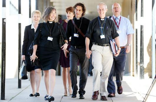 The Archbishop of Canterbury, the Most Rev Justin Welby, second right, arrives for the General Synod of Church of England meeting at The University of York