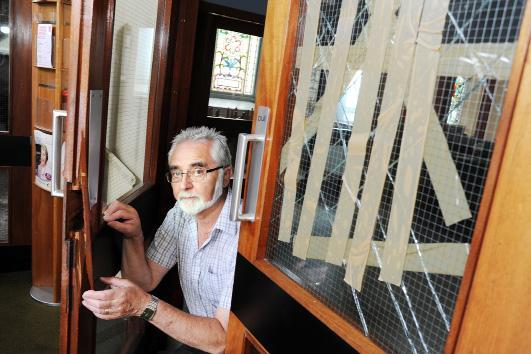 Church steward David Foster shows the damage after Brierfield Methodist Church was broken into