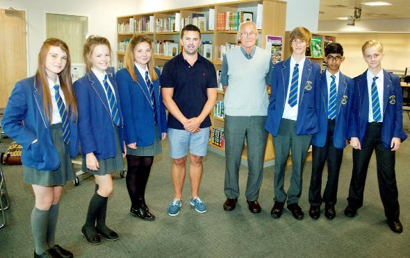 Former Burnley players Paul Weller and Jimmy Robson with pupils at the World Cup theme day