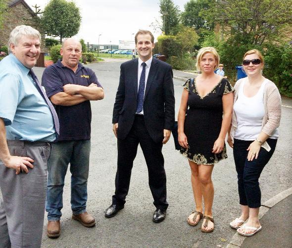 From left, Andrew Coombe,  principal officer developer support team at LCC, Coun Karl Kempson, Jake Berry and two local mums outside Waterfoot Primary School