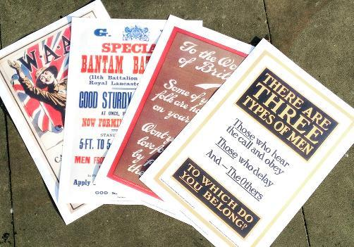 A selection of the posters from the Great War going up in Colne town centre where they have already gained attention