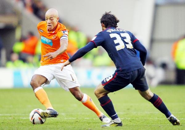 Defender Alex Baptiste has joined Blackburn Rovers on a season-long loan from Bolton Wanderers