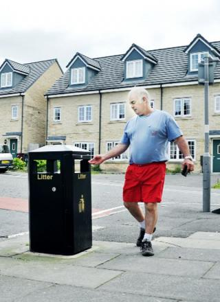 Cliff Legg tries out the new smaller bin on the corner of Anyon Street and Walmsley Street