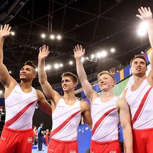 England's Louis Smith, Max Whitlock, Nile Wilson and Kristian Thomas wave to the crowd after scoring a total of 266.804