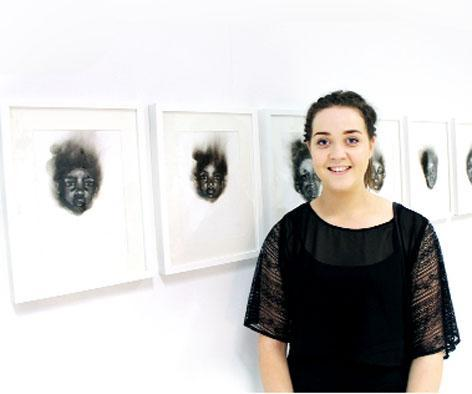 Jessica Hayes with some of her work which she created with candles