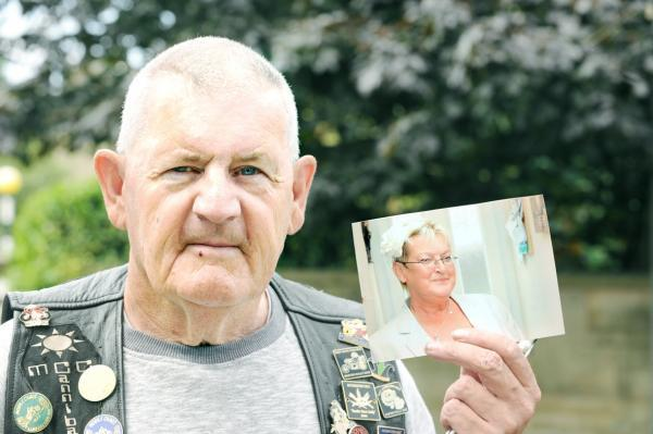 Alan McDonald holds a picture of his wife, Maureen