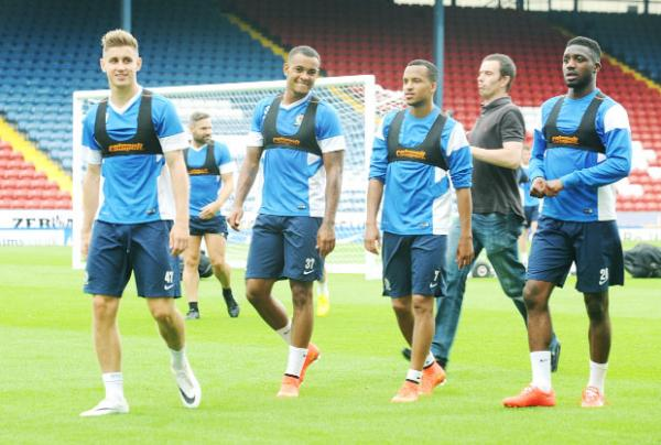 Rovers players train on the Ewood Park pitch watched by fans