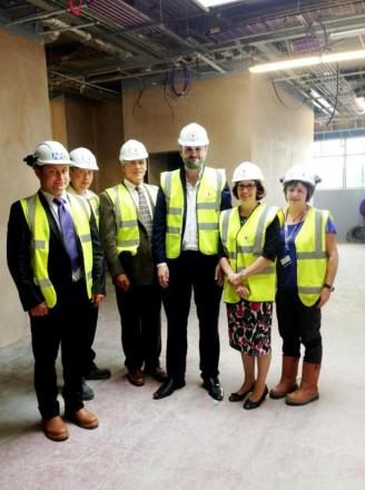 Pendle MP Andrew Stephenson, third from right, tours the new A&E unit under construction  at Airedale Hospital