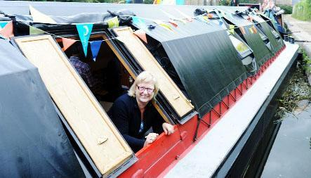 Judy York on her boat, the Swallows Nest, at last year's festival,
