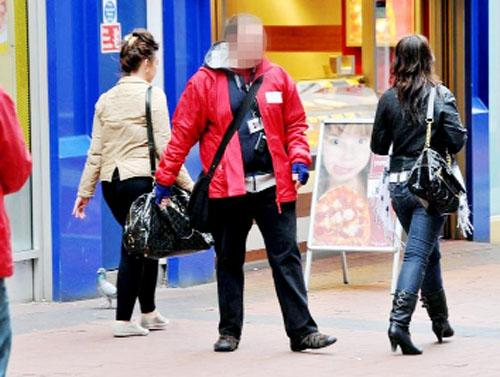 A 'chugger'  approaches shoppers with his business patter