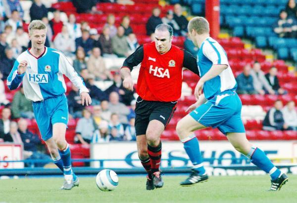 Former Rovers midfielder Mark Atkins takes on Paul Gallagher and Andy Todd on his return to Ewood Park