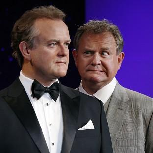 Hugh Bonneville meets his waxwork at Madame Tussauds
