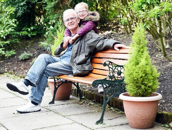 Pat Ellis and his granddaughter Ella Lord, 6, both of Nelson, are delighted with the return of the stolen bench