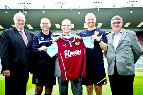From left, Steve Cook, assistant manager Ian Woan, Carlton Cooper, manager Sean Dyche and Clive Holt