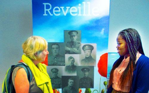 Project volunteer Kasongo Swana and library regular Isabel Butler discuss Reveille