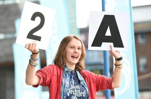 Blackburn College Student Victoria Smith 17 of Blackburn celebrates collecting 2 A's and 1 B in her A levels at Blackburn College.