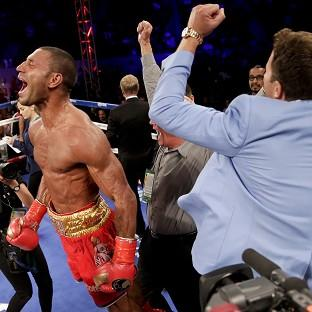 Kell Brook, left, celebrates his win against Shawn Porter (AP)